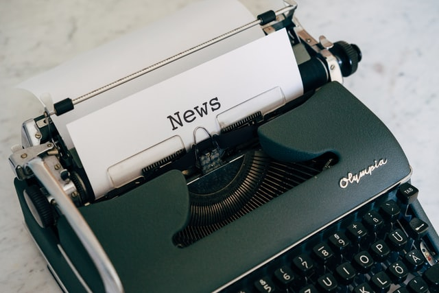 "Typewriter with piece of paper that says ""News"""